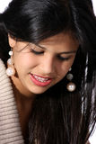 Beautiful and shy. Attractive young woman looking down shyly Royalty Free Stock Photography