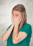 Beautiful shy girl with green t-shirt covering her face Stock Photography