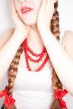 A beautiful shy young folk woman Royalty Free Stock Image
