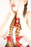 A beautiful shy young folk woman Stock Image