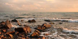 Beautiful sight of a stony seashore before Stock Images