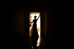 Beautiful silhouette of a bride in her wedding dress Stock Photos