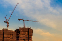 Beautiful silhouette of construction tower cranes with sunset sk Stock Photography