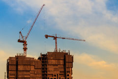 Beautiful silhouette of construction tower cranes with sunset sk Stock Photo