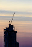 Beautiful silhouette of construction tower cranes with sunset sk Stock Image