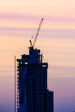 Beautiful silhouette of construction tower cranes with sunset sk Royalty Free Stock Photos