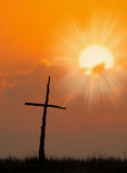 Beautiful silhouette of Cross. And sunrise over a meadow on a cool fall morning Stock Photo