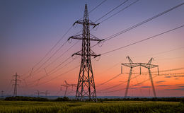 Beautiful Silhouette of Electricity Towers. Stock Photos