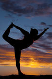 Beautiful silhouette of female model in yoga pose Stock Photos