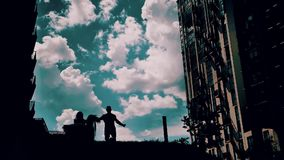 Beautiful silhouette of a guy and a girl against the beautiful sky. nice shots. emotions feelings and love. Stunningly beautiful sky stock footage