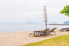 Beautiful Silhouette luxury umbrella and chair around swimming p Stock Photo