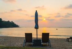 Beautiful Silhouette luxury umbrella and chair around swimming p Stock Photography