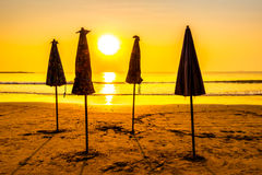 Beautiful Silhouette umbrella on the beach and sea Royalty Free Stock Photos