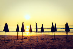 Beautiful Silhouette umbrella on the beach and sea Royalty Free Stock Photo