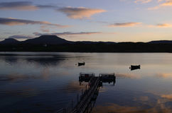 Beautiful Silhouetted Pier on Loch Dunvegan. Gorgeous silhouetted pier and boats on Loch Dunvegan at Dawn Royalty Free Stock Image