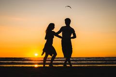 Beautiful silhouettes of dancers at sunset stock images