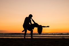 Beautiful silhouettes of dancers at sunset royalty free stock images