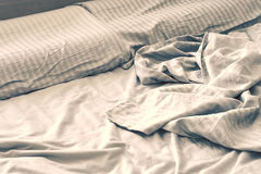 Silk crumpled linen on the bed Stock Photos
