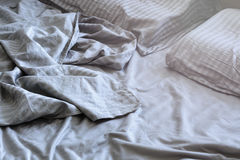 Silk crumpled linen on the bed Stock Photo