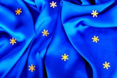 Beautiful silk wavy fabric blue with stars Royalty Free Stock Photo