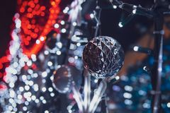 Beautiful silver bauble hanging on the wall. stock photo