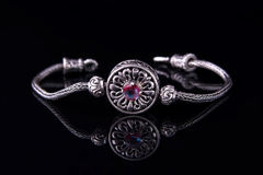 Beautiful silver bracelet on black background Royalty Free Stock Photo