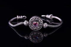 Beautiful silver bracelet on black background royalty free stock photo
