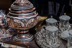 Beautiful silver coffee cups in souvenir shop in Sarajevo. Beautiful silver coffee cups and the pot in souvenir shop in Sarajevo, Bosnia royalty free stock photography
