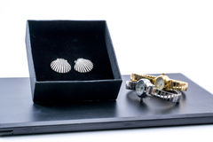 Beautiful silver earrings in a box and two watches Stock Photos
