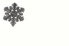 Beautiful silver grey sparkling winter snowflake Stock Photography