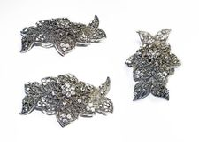 Beautiful silver hair clip. Beautiful openwork silver hairpin with three camera angles on a white background stock image