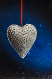 Beautiful silver heart on a shiny background Stock Photography