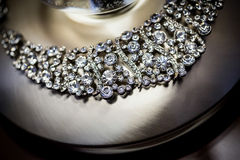 Beautiful silver jeweled necklace on burnished aluminum Royalty Free Stock Images