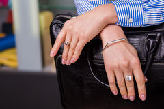 Beautiful silver jewelry on women's hands close up. Business style clothing. Accessories closeup Stock Image