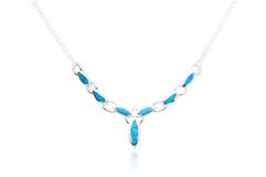 Silver necklace decorated by turquoise Royalty Free Stock Images