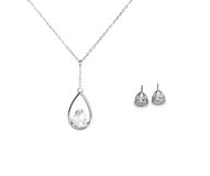 Beautiful silver necklace and diamond earrings isolated on white Royalty Free Stock Photos