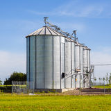 Beautiful silver silos in landscape Royalty Free Stock Images