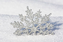 Beautiful silver snowflake in snow. At christmastime Stock Image