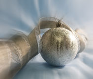 Beautiful silvery New Year ball and elegant tinsel Stock Image
