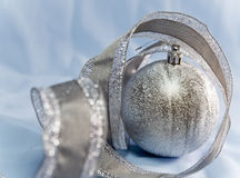 Beautiful silvery New Year ball and elegant tinsel Royalty Free Stock Photos