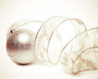 Beautiful silvery New Year's ball and elegant tinsel Royalty Free Stock Photography