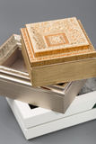 Beautiful simple hand-made boxes on a gray background Stock Photography