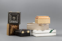 Beautiful simple hand-made boxes on a gray background Royalty Free Stock Photography