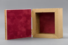 Beautiful simple hand-made boxes on a gray background Stock Images