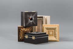 Beautiful simple hand-made boxes on a gray background Royalty Free Stock Photos