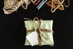 Beautiful simple present in amazing green wrapping paper with gr Royalty Free Stock Photography