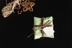 Beautiful simple present in amazing green wrapping paper with gr Stock Image