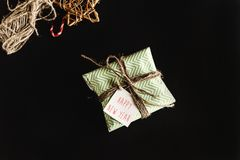 Beautiful simple present in amazing green wrapping paper with gr Royalty Free Stock Photo