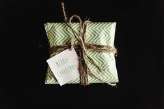 Beautiful simple present in amazing green wrapping paper with gr Royalty Free Stock Image
