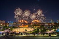 Beautiful Singapore national day fireworks at national stadium.  Stock Photos